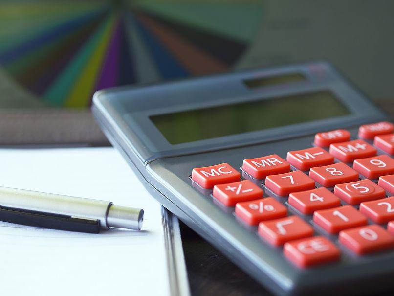 calculadora e caneta